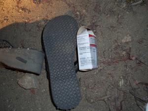 Flip Flops and asthma inhaler below the Donut Hole 3JUL08