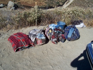 Blankets, booties and clothes picked up off the ground west of Bell Valley