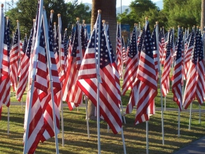 Each flag has a tag with the name of a fallen soldier