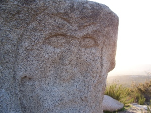 Face on rock at 138