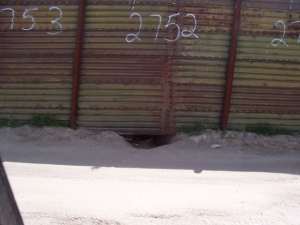 One of many holes under fence in Tierra Del Sol area