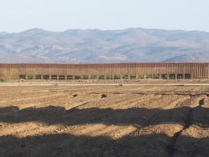 Holes in the new fence near Jacumba, California